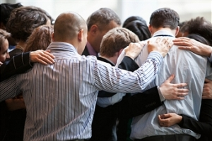 praying in a huddle